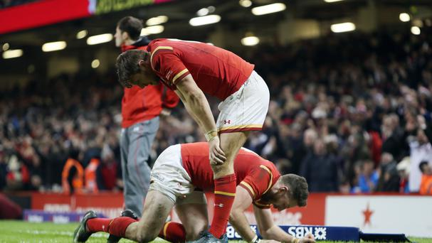Alex Cuthbert hangs his head after England score their match-winning try against Wales