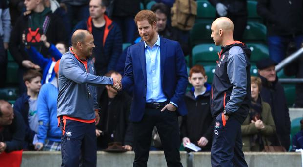 Prince Harry, centre, greeted England head coach Eddie Jones at Twickenham