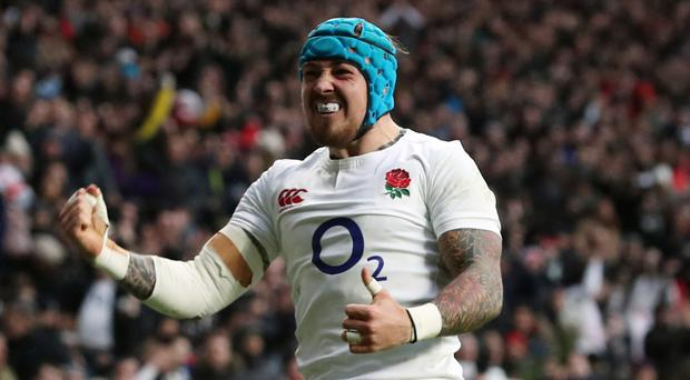 Jack Nowell scored two late tries for England
