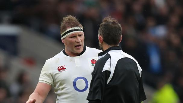 England captain Dylan Hartley (left) chats with referee Romain Poite during the match against Italy