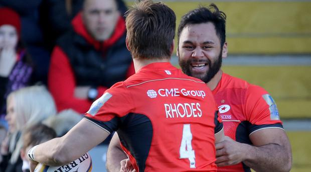 Saracens lock Michael Rhodes celebrates his opening try with team-mate Billy Vunipola, right