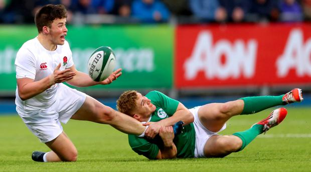 Hang on: Ireland's Jordan Larmour tackles Will Butler at Donnybrook
