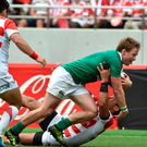 My try: Ireland's scrum-half Kieran Marmion goes over the line against Japan