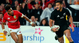 Hard yards: New Zealand All Blacks Rieko Ioane races away for a try from Anthony Watson of the Lions
