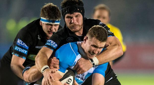Tussle: Warriors' Tim Swinson with Rory O'Loughlin
