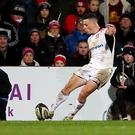 On target: John Cooney kicks a conversion for Ulster