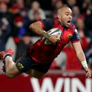 Taking flight: Munster's Simon Zebo scores a try against Castres