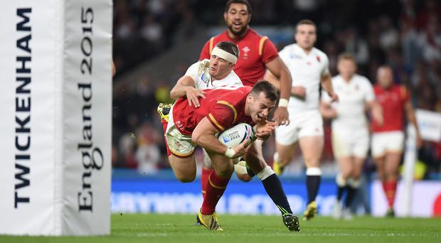 Wales' Gareth Davies dives in to score a try against England