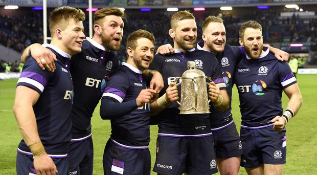 Scotland's Huw Jones, Ryan Wilson, Greg Laidlaw, John Barclay, Stuart Hogg and Tommy Seymour celebrate with the Calcutta Cup