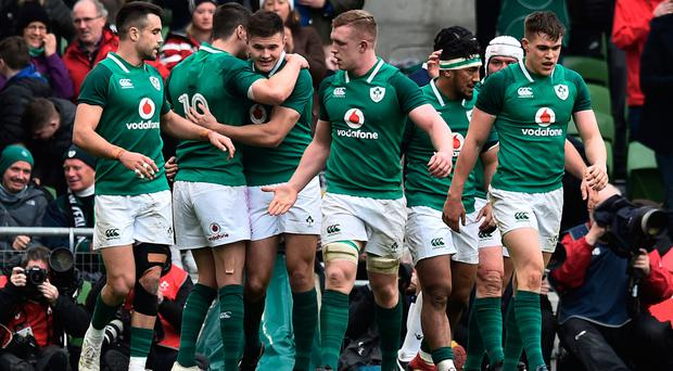 Title triumph: Ireland players celebrate during their victory over Scotland
