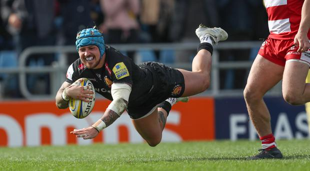 Jack Nowell plunges over for one of his two tries