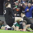 Jacob Stockdale scores a try in Ireland's victory (Niall Carson/PA)