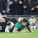 Jacob Stockdale stretches for the winning try in Ireland's 16-9 victory over New Zealand (Niall Carson/PA)