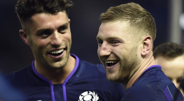 Adam Hastings, left, and Finn Russell will start alongside each other for Scotland for the first time against Argentina on Saturday (Ian Rutherford/PA)