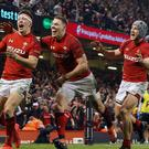 Josh Adams (left) celebrates his late try for Wales (Paul Harding/PA)