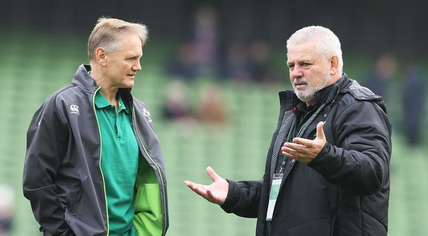 Ireland boss Joe Schmidt, left, has raised queries about Wales and head coach Warren Gatland, right, regarding the roof in Cardiff (Brian Lawless/PA)