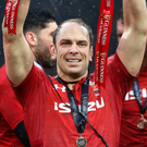 Grand feeling: Alun Wyn Jones lifts the Six Nations trophy after completing the clean sweep against Ireland