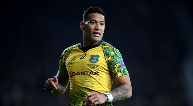Israel Folau has been found in breach of the Rugby Australia code of conduct (Adam Davy/PA)