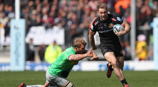 Exeter's Sam Hill gets away from Harlequins' Chris Robshaw (David Davies/PA)