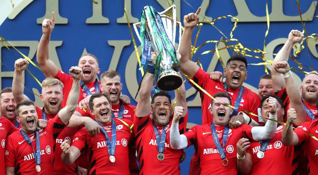 Saracens celebrate with the Champions Cup trophy (David Davies/PA)