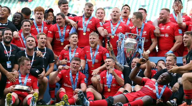 Saracens players enjoy their celebrations after winning the Gallagher Premiership trophy. (Paul Harding/PA)