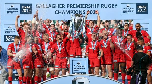 Saracens players lift the trophy following victory in the Gallagher Premiership Final at Twickenham Stadium, London.