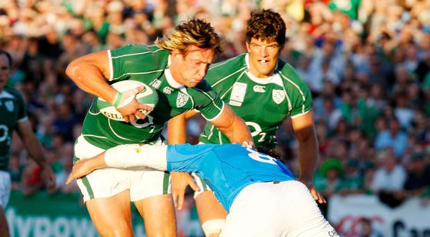 Poor show: Ireland's Neil Best is tackled by Italy's Sergio Parisse