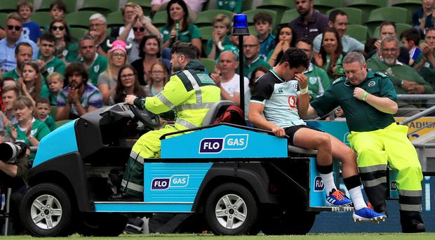 Joey Carbery of Ireland leaves the field injured during the Guinness Summer Series match against Italy.