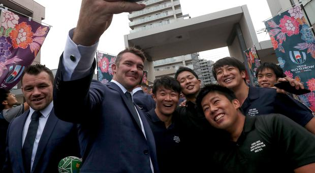 Picture perfect: Peter O'Mahony takes a picture with fans at yesterday's welcome ceremony