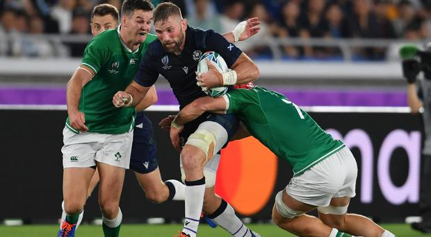 Scotland's John Barclay is tackled by Ireland's Johnny Sexton and Josh van der Flier during the Rugby World Cup Pool A match in Yokohama.