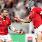 Wales centre Jonathan Davies, seen here in the group stages, has been named to take on France in the quarter-final after recovering from a knee injury (David Davies/PA)
