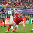Wales' Hadleigh Parkes scores his sides first try during the 2019 Rugby World Cup match at the Tokyo Stadium, Japan.