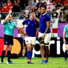 Jaco Peyper shows France's Sebastien Vahaamahina a red card (David Davies/PA)