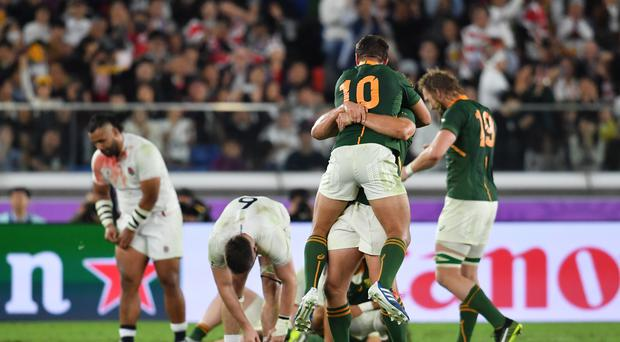 South Africa's Handre Pollard celebrates their World Cup triumph as England's players are left dejected (Ashley Western/PA)