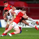 Crunch: Ulster's Stuart McCloskey is tackled by Munster's Rory Scannell and CJ Stander last Saturday