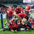 Big moment: Munster celebrate James Cronin's crucial bonus point try last week at Ospreys