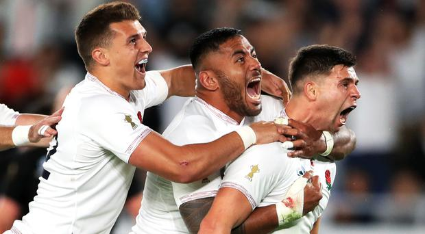 England's Ben Youngs, right, celebrates scoring a try with Henry Slade, left, and Manu Tuilagi (Adam Davy/PA)