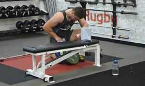 Nick Timoney cleaning his weights bench