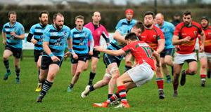 Changed times: Ballymoney (in blue) in pre-lockdown game against Larne