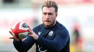 Stuart Hogg wants Scotland to get in the faces of France once again when they meet on Sunday (David Davies/PA)