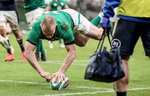 At the double: Keith Earls touches down for one of his two tries against Scotland