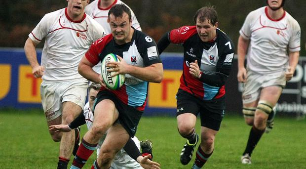Race on: Harlequins' Andrew McGrath on the attack