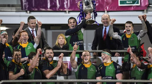 Champagne moment: Ballynahinch captain Harry McAleese leads the celebrations last night