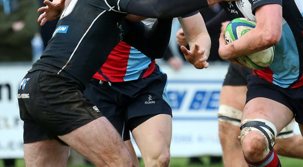 No way through: Ballymena's Ricky Andrew (left) holds up Mark Wylie of Belfast Harlequins