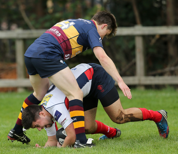All fours: Malone's Shane Kelly tries a novel way of getting past Banbridge's Adam Ervine
