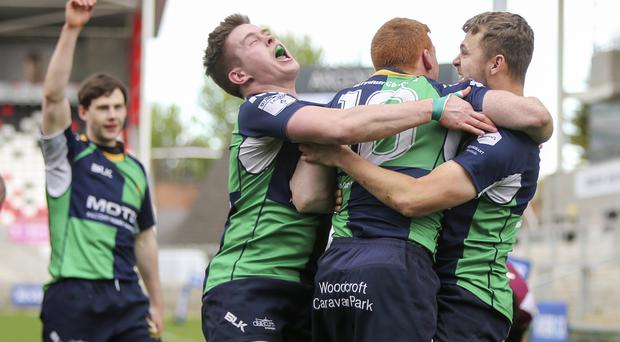 Match winner: Chris Gibson and James McBriar congratulate Chris Orr after he scored the winning try during the RiverRock Ulster Towns' Cup Final