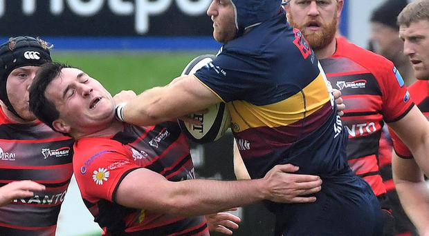 Back off: Armagh's John Faloon (left) tangles with Chris Allen of Banbridge in Saturday's Cup game