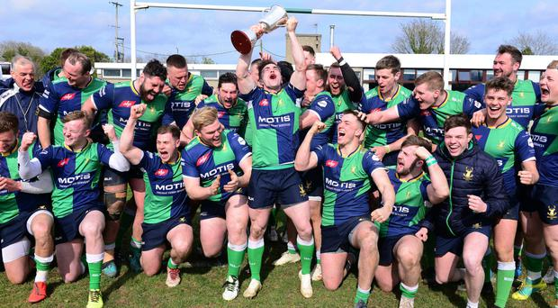 Champions: Aaron Cairns and his Ballynahinch team-mates celebrate clinching the 1B title