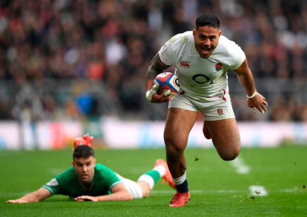 Charging on: Manu Tuilagi goes past Conor Murray