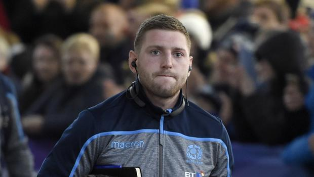 Finn Russell 's Six Nations future with Scotland is in doubt (Ian Rutherford/PA)